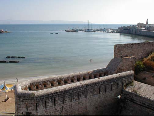 Acre - عكا : Part of the wall to guard the southern gate of the city with the port in the backgroung and Haifa is farther back