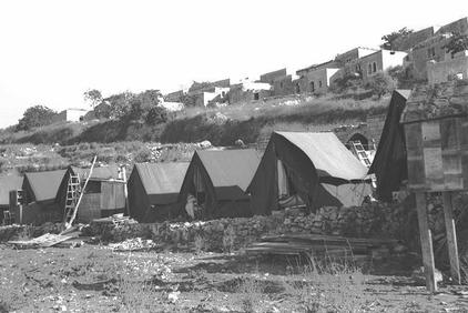 Suhmata - سحماتا : Suhmata after occupation #1, 1949. Note the tents for the Israeli settlers preparing to take over the homes. Palestinian homes were the primary residential units for Jewish refugees from all over the world soon after Nakba.