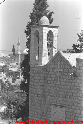 Tarshiha - ترشيحا : A Scene In Tarshiha, A Picture Of A Church & A Mosque In The Background, 1976