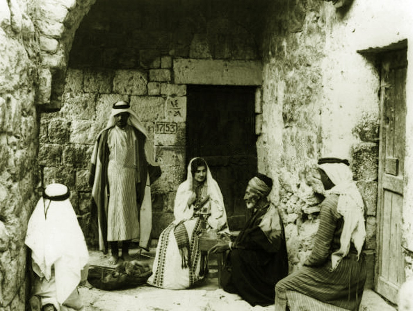 Bethlehem - بيت لحم : PALESTINE - Bethlehem, 1890s (early 20th c.) 48 circa 1925: A group of Palestinians talking outside their houses in Bethlehem. (Photo by Chalil Raad, Palestine's first Arab photographer, 1854-1957)