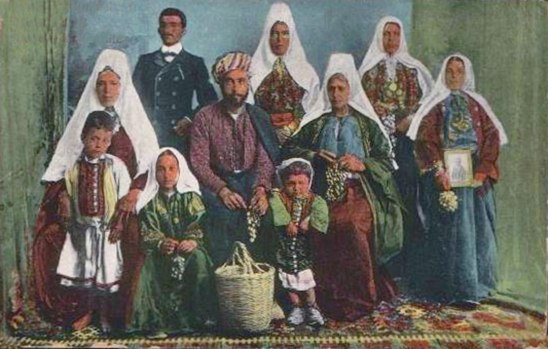 Bethlehem - بيت لحم : A Palestinian family of Bethlehem, 1890s (Note the woman holding framed picture and flowers)