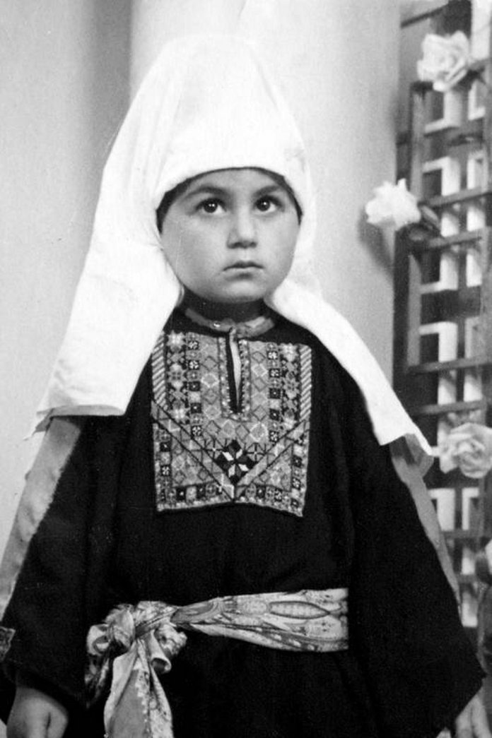 Bethlehem - بيت لحم : Women of Bethlehem 129 (circa 1959) - A young girl of Bethlehem in traditional Thob and Shatweh (Per Reem Ackall)