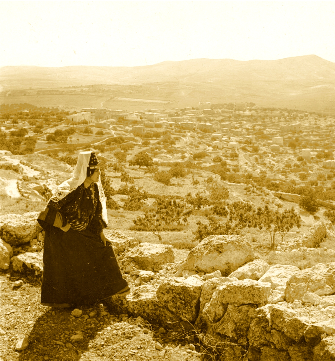Bethlehem - بيت لحم : Women of Bethlehem 145 (late 19th, early 20th c.) - In the Hhlls and fields North from Bethlehem, showing road to Jerusalem (Per Reem Ackall)
