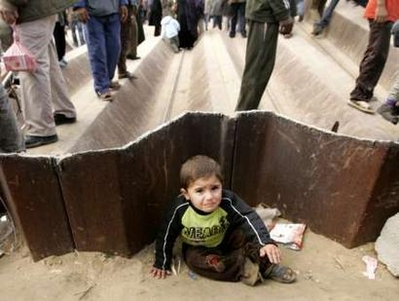 Gaza Jail Break - فك طوق الأسر عن اهل غزة : A Gaza boy waiting to be picked by his parents who were on their way to Egypt to buy goods after more than a year of Western managed stravation