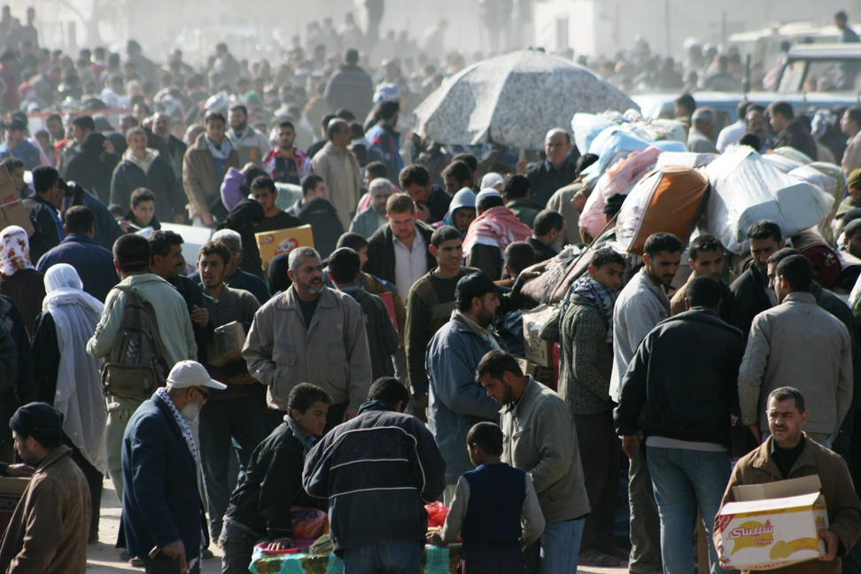 Gaza Jail Break - فك طوق الأسر عن اهل غزة : Contemplate the masses, all shop in Egypt, nothing left to buy. Within few days, over 800,000 Palestinians crossed the borders to stock up on basic essentials after destroying the starvation wall.