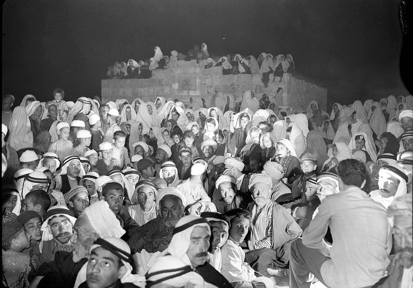 Halhul - حلحول : Halhul village with large group of people gathering & waiting for a cinema show 1940.