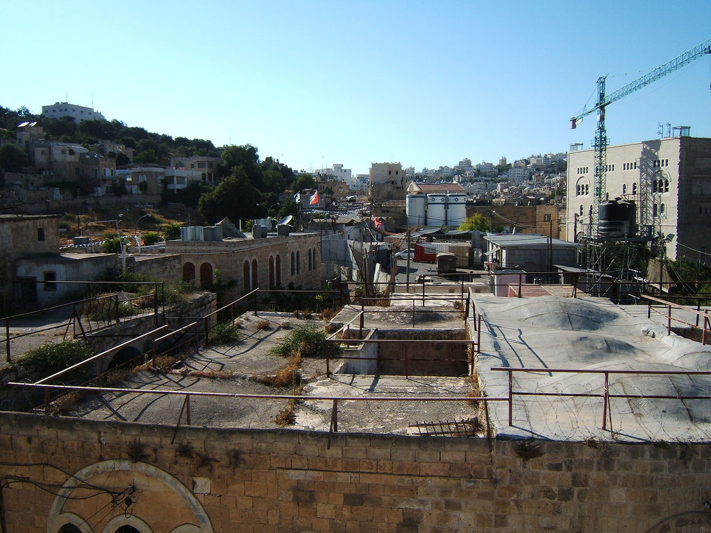 Hebron - الخليل : General view of the old city, notice the Israeli Jewish colony inside