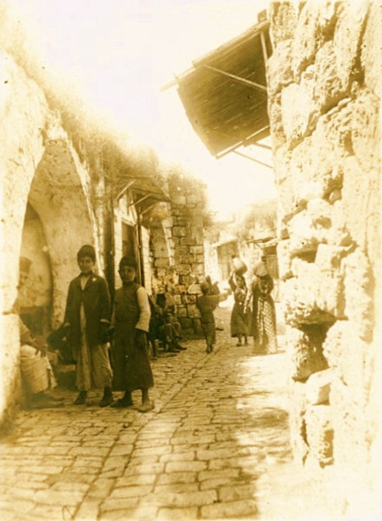 Jinin - جنين : JININ - Late 19th, early 20th c. 23 - Palestinians in an alleyway in Jinin, circa 1917