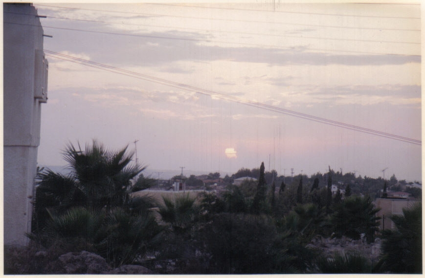 Kafr Sur - كفر صور : Solar eclipse of 1994 on the western horizon taken from the front of the library at the masjid compound.