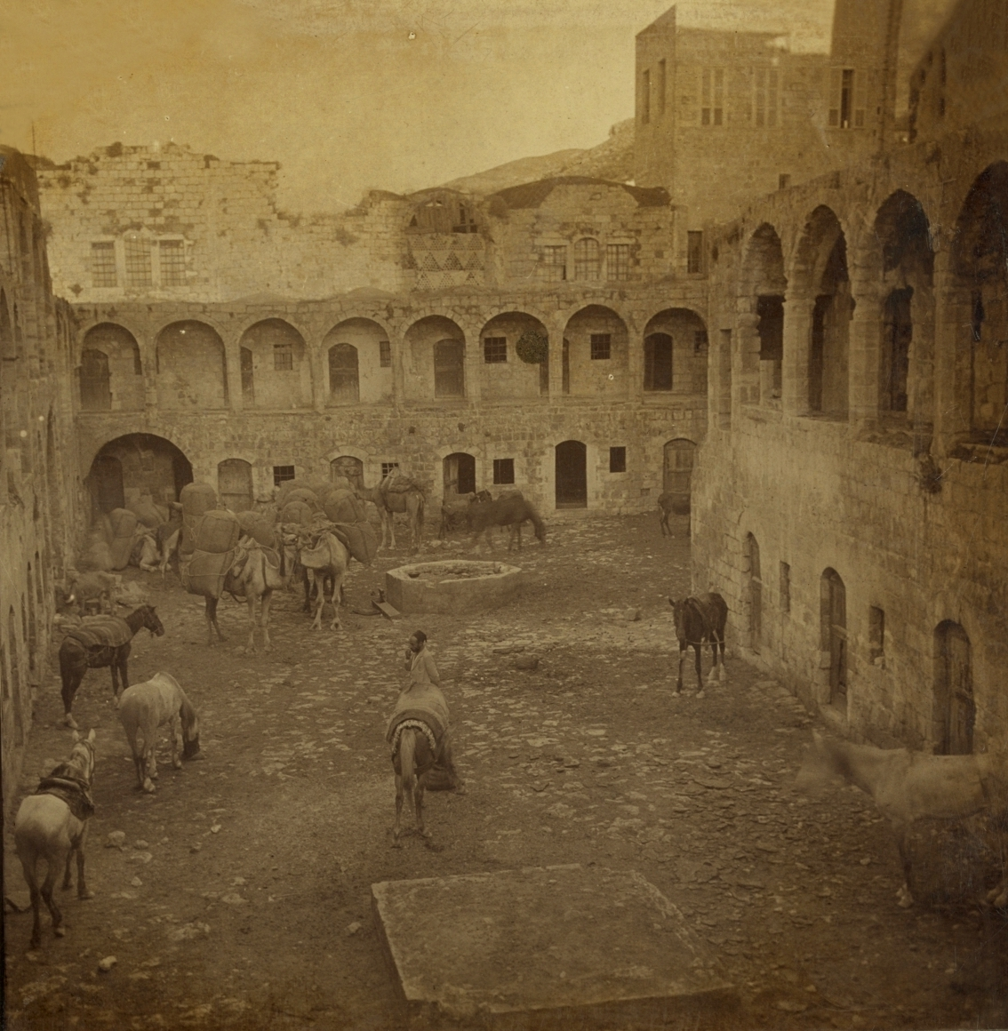 Nablus - نابلس : NABLUS - Late 19th, early 20th c. 24 - Courtyard of old Kahn, showing loaded caravan, 1905
