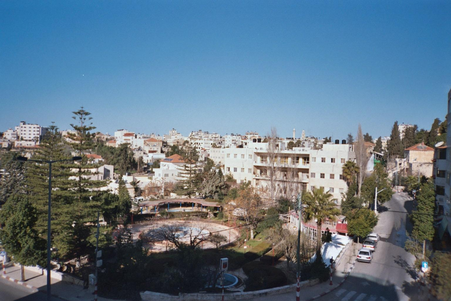 Ramallah - رام الله : General view of the old downtown area, city hall can be seen, friends' girls school to the right, Catholic school ahead, and to the left the famous muntazah