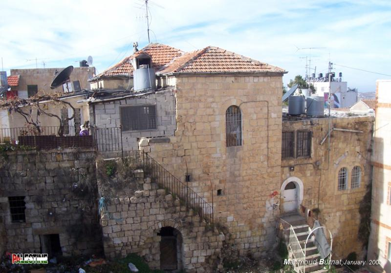 Ramallah - رام الله : An old Palestinian house in the Old City. A typical Palestinian architecture with arches, staircases, and iron work