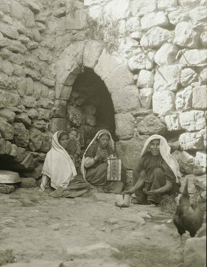Ramallah - رام الله : Peasant girls from the Jerusalem-Ramallah area in a courtyard embroidering, early 20th c.