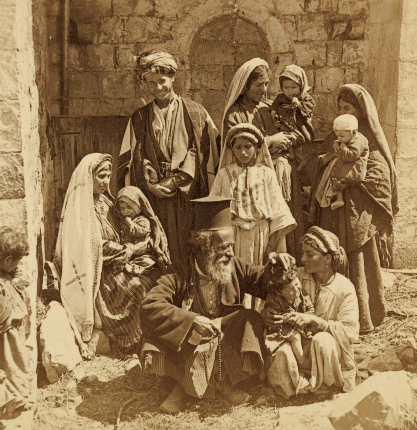 Ramallah - رام الله : RAMALLAH - Greek Orthodox priest blessing a family in Ramallah, palestine, late 19th c. (High Res.)
