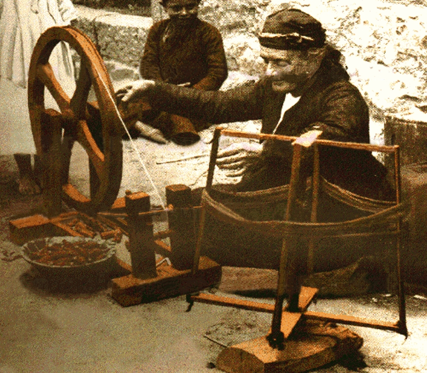 Ramallah - رام الله : Old Palestinian woman-weaver of Ramallah winding a spindle - (Early 20th. c.)