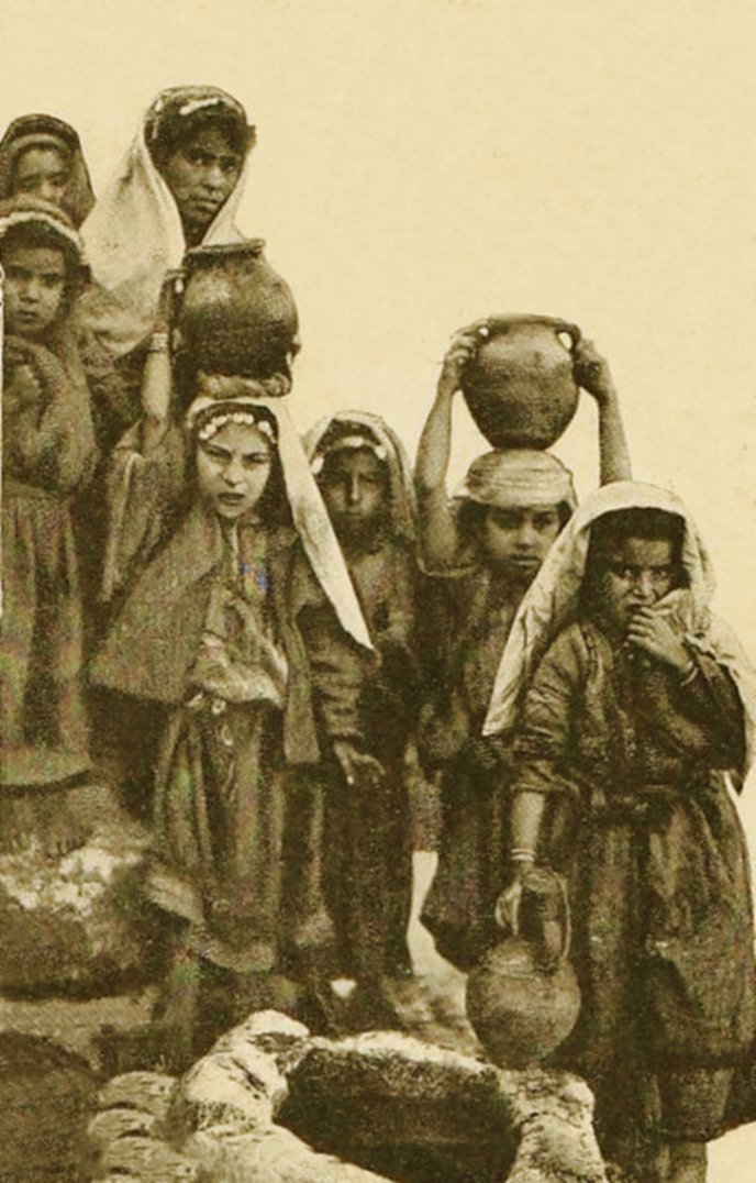 Ramallah - رام الله : RAMALLAH - Young girls of the Ramallah-Bireh area with water jars at local well, circa 1900s (Per Reem Ackall)