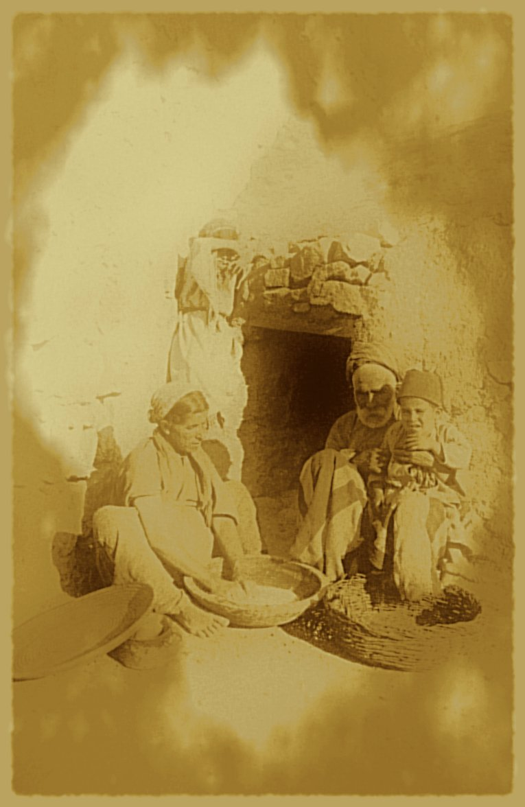 Ramallah - رام الله : RAMALLAH - A Palestinian family at the village oven in the Ramallah area, circa 1920s-30s (Per Reem Ackall)