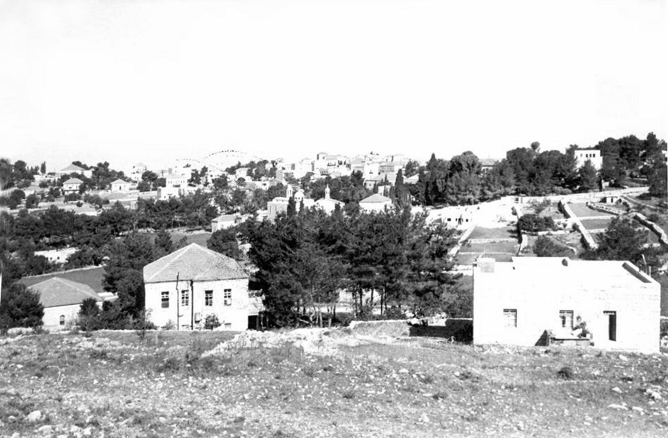 Ramallah - رام الله : RAMALLAH - A view from Al-Nuzha St. looking towards Old Ramallah. At the centre: (behind the trees) is Al-Muntazah, and the bell towers of the Catholic Church, circa 1960. (Per Beautiful Ramallah, on Facebook).
