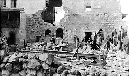 Sharafat - شرفات : On the morning of February 7, 1951, Zionist Terrorists blew up this home in the village of Sharafat. This is an actual photo of the dreadful scene of the damaged house with its rubble piled on top of its murdered occupants.