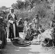 'Isfiya - عسفيا  :  Druze women baking bread in Isfiya. 1900-1920. This picture was provided by IMAD TELHAMI