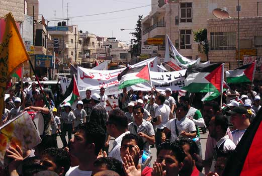 al-Ram - الرامّ : A thousand people came together to protest the ghettoization of ar Ram and the Judaization of the Palestinian capital Jerusalem.