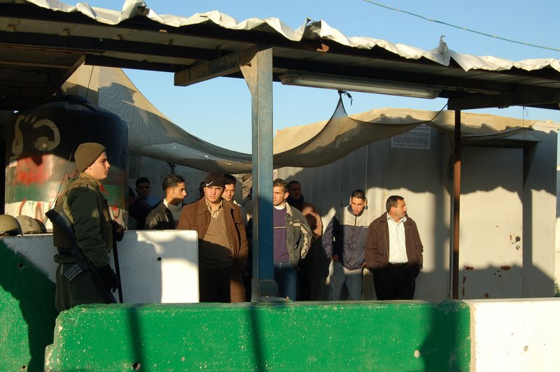 al-Ram - الرامّ : Ar-Ram checkpoint. Palestinian detainees, guarded by a soldier at Ar-Ram checkpoint.