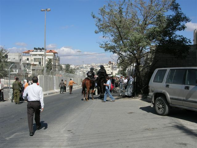 al-Ram - الرامّ : Soldiers, including horsemen block Palestinians from crossing to Jerusalem during the time of Ramadan.
