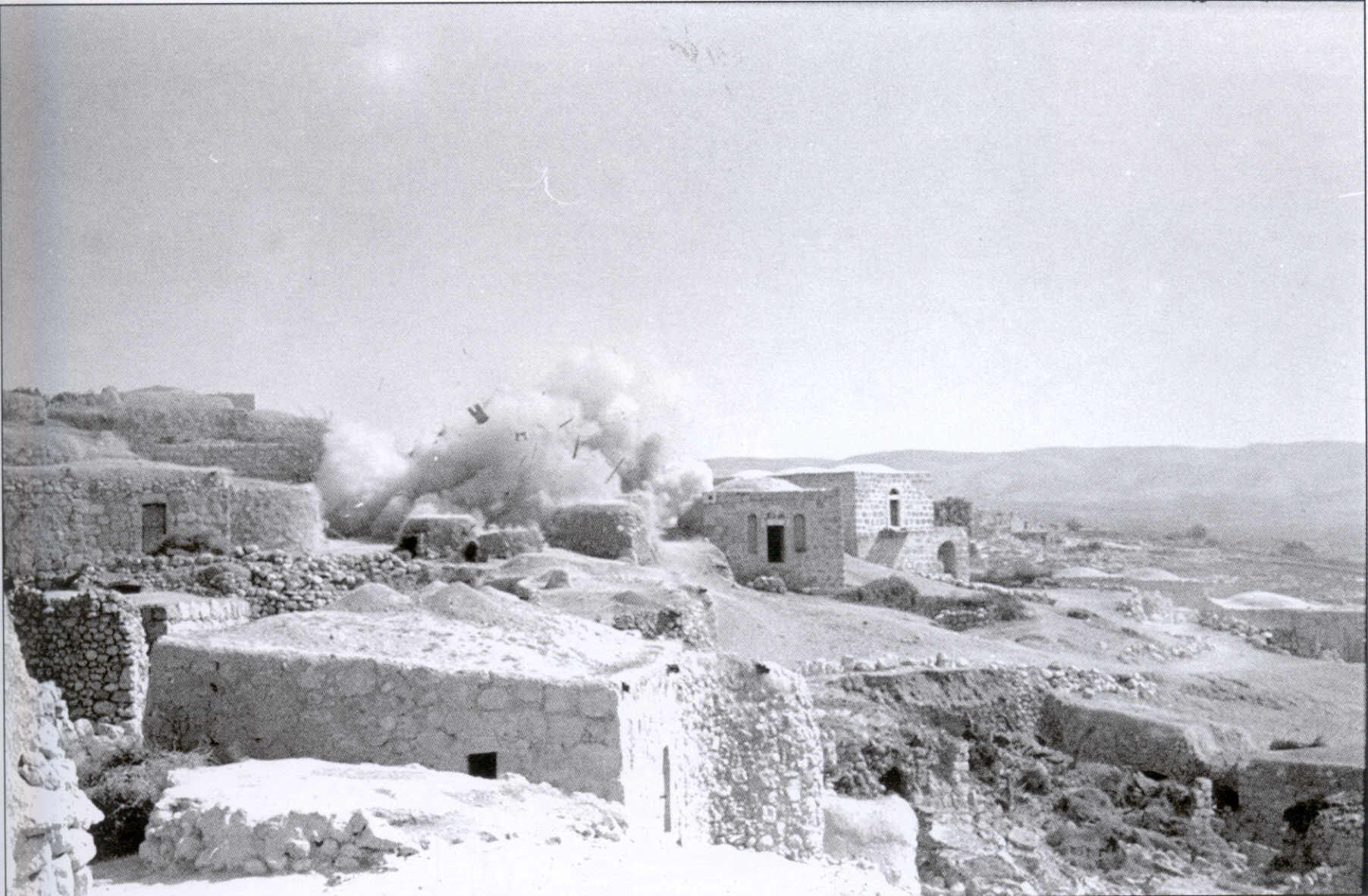 Bayt Nattif - بيت نتّيف : Rare picture for the village as Israelis are destroying it soon after occupation. 1949
