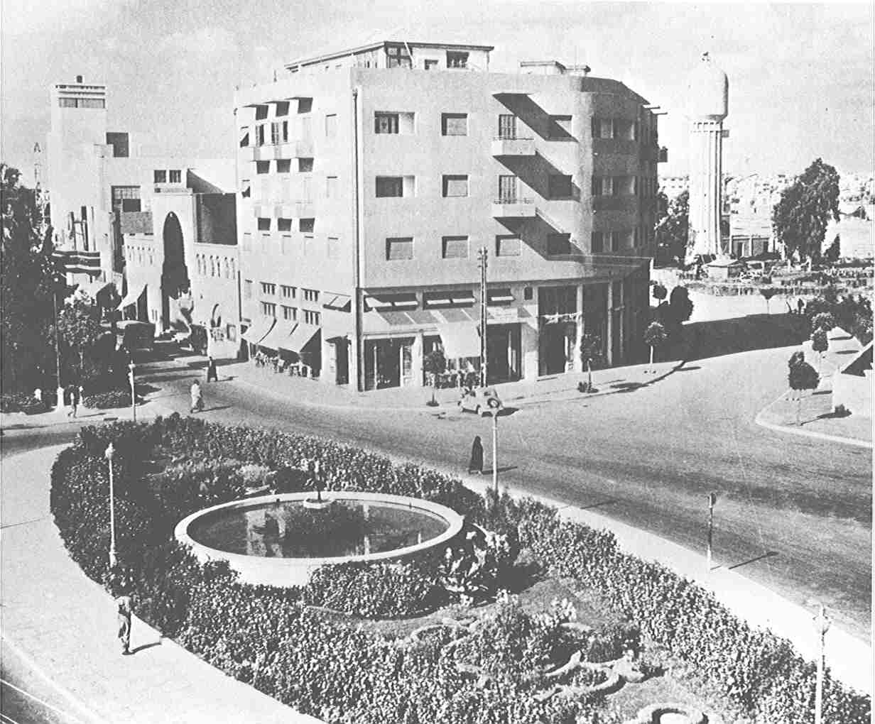 Jaffa - يافا : Jaffa's downtown in the 1940s. Note al-Hamra cinema theater on the far left, and the water tower on the right hand side. The building in the middle is the new city hall