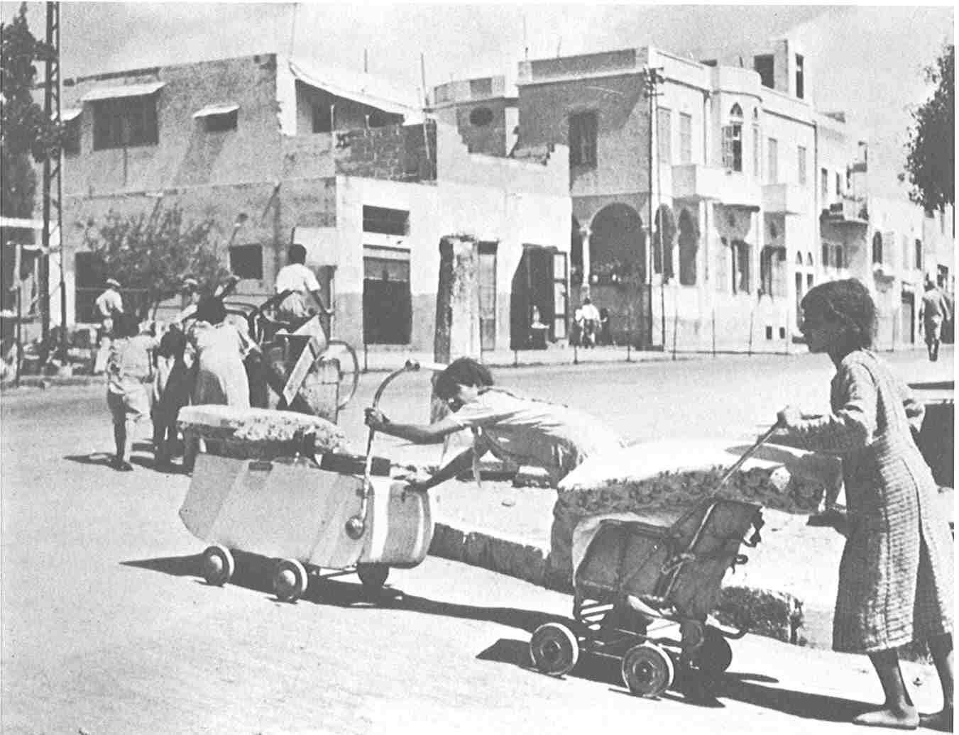 Jaffa - يافا : Jaffa's residents attempting to salvaging whatever they can as they being ethnically cleansed, May 1948. For many this was a difficult journey, and the majority never saw Jaffa again.
