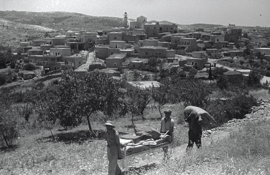 al-Maliha - المالحه : RARE picture for al-Maliha taken soon after Nakba (1-6-1949) and in the forground Israeli Jews looting Palestinian properties.