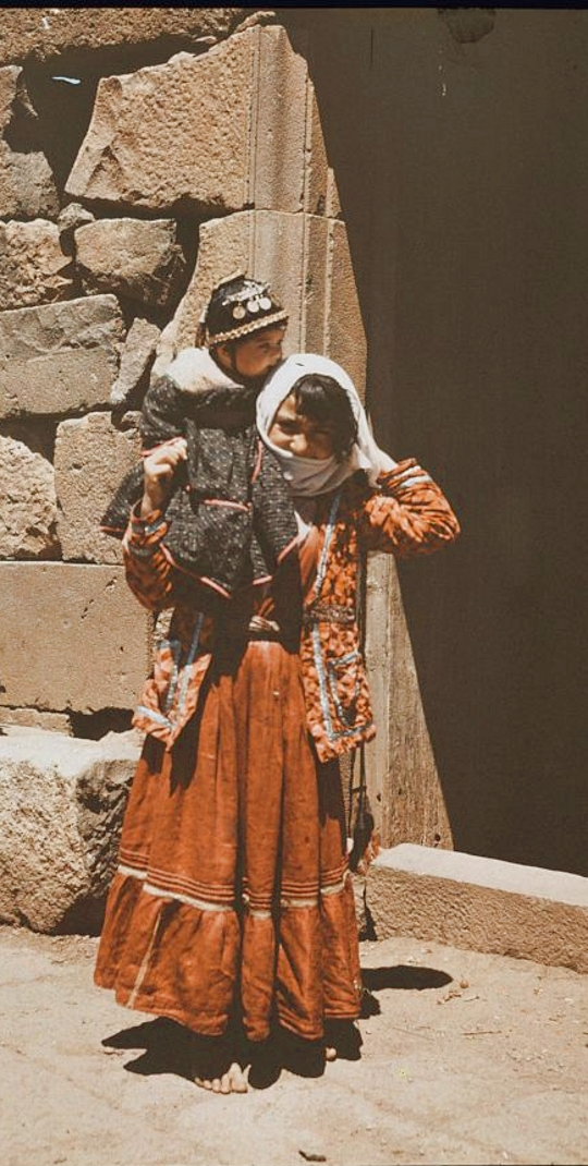 Nazareth - الناصرة : Women of Nazareth 29 (1930s) - Girl from Nazareth, northern Palestine carrying baby, also possibly from southern regions of Syria or Lebanon