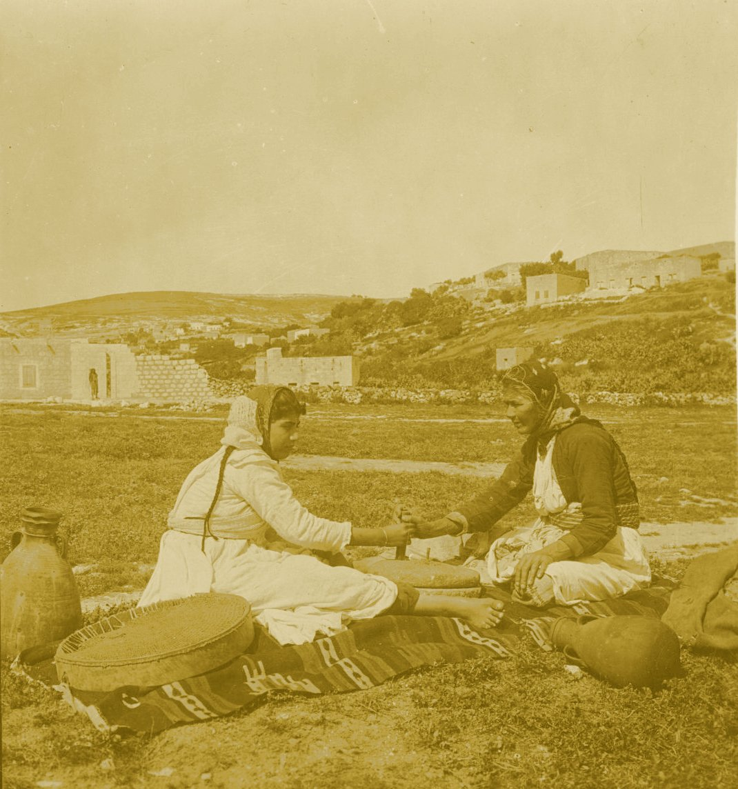Nazareth - الناصرة : NAZARETH - Women of Nazareth 45 (Late 19th, early 20th c.) - Two women grinding in field. (Per Reem Ackall)