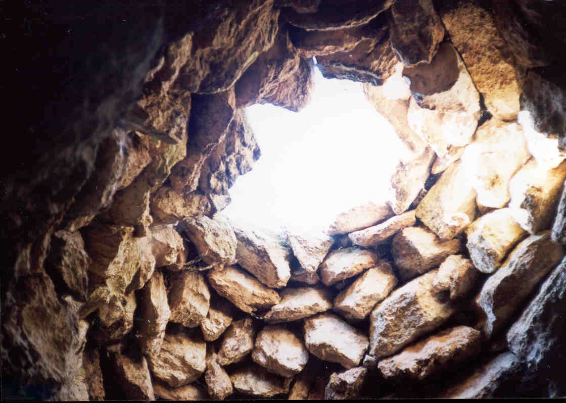 The roof of the cave-house with chimney-hole, February 2002
